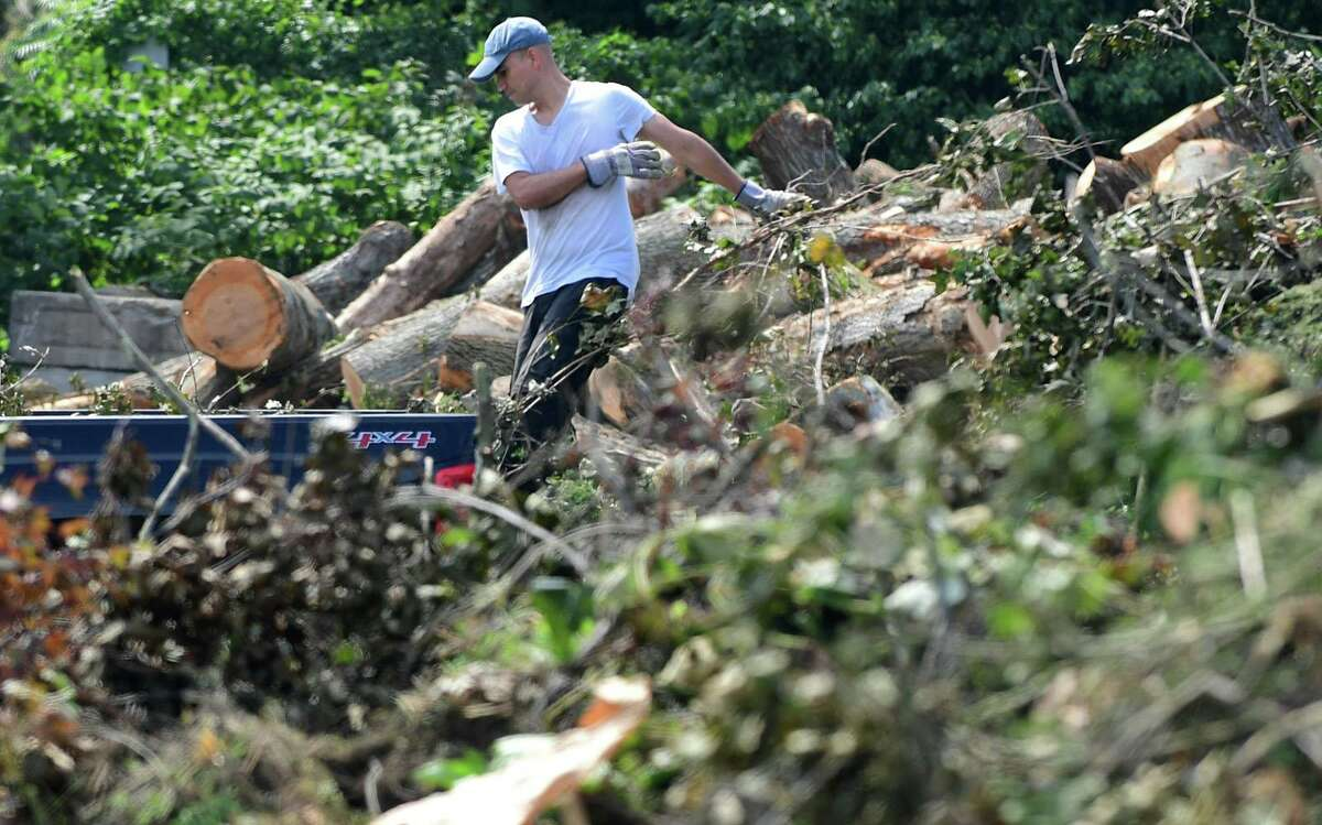 Greenwich residents dump their lawn refuse at the Holly Hill Transfer Station Saturday, August 15, 2020, in Greenwich, Conn.