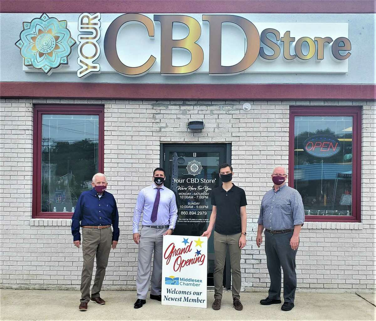 From left, President of the Middlesex Chamber of Commerce Larry McHugh, Your CBD Store owner Steven Nardiello, Middletown Mayor Ben Florsheim and Chamber Chairman Tom Byrne participated in the grand opening recently.
