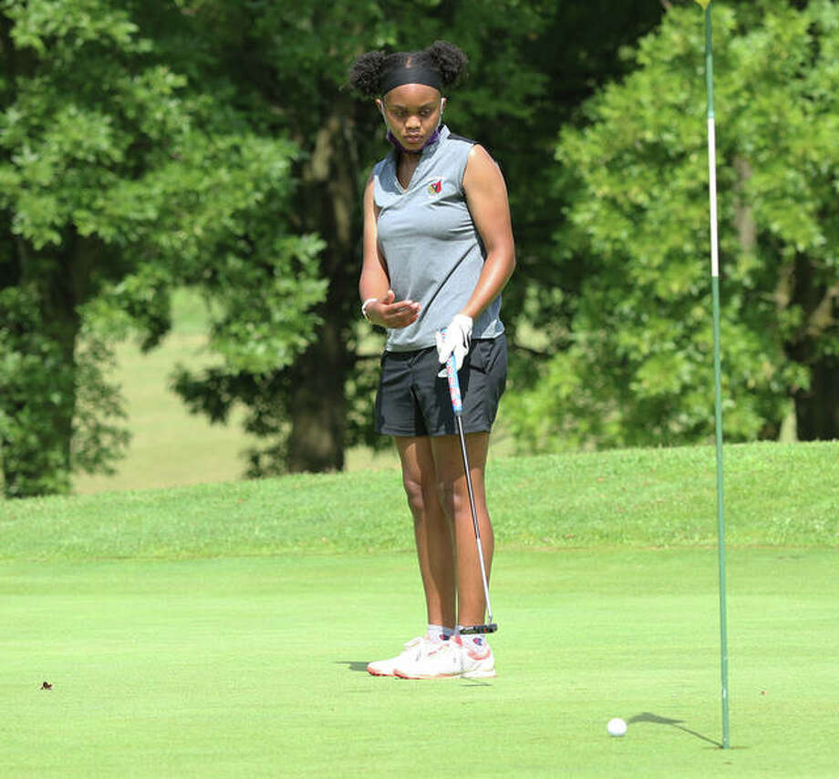 Alton freshman Na'ilah Simmons tries to wave her putt closer to the cup, but comes up short during the Alton Fall Kick-Off Scramble/Shamble on Saturday afternoon at Rolling Hills golf course in Godfrey. Photo: Greg Shashack / The Telegraph