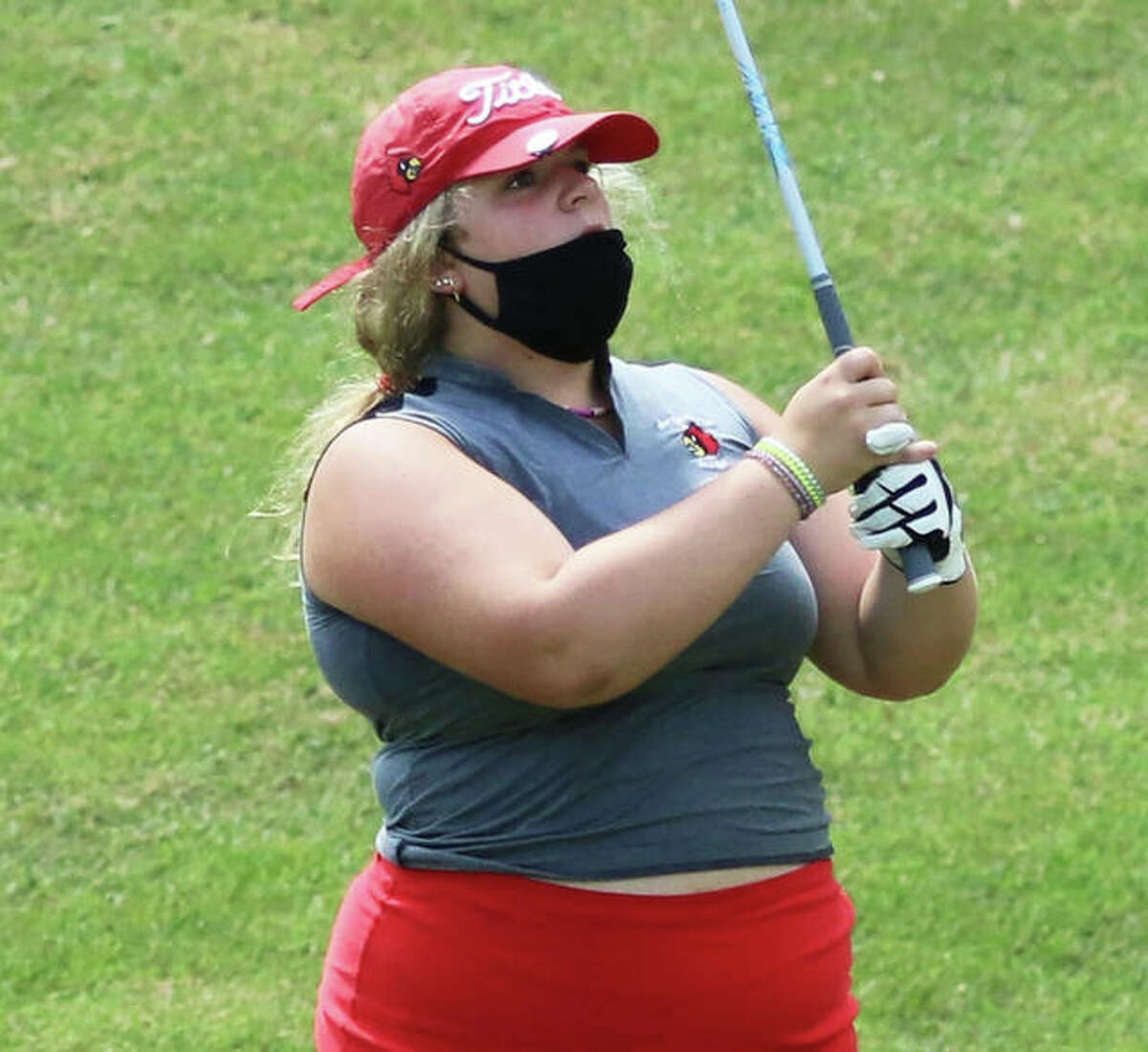Alton's Josie Giertz watches her iron shot early in her round Saturday at the Alton Fall Kick-Off Scramble/Shamble at Rolling Hills in Godfrey.