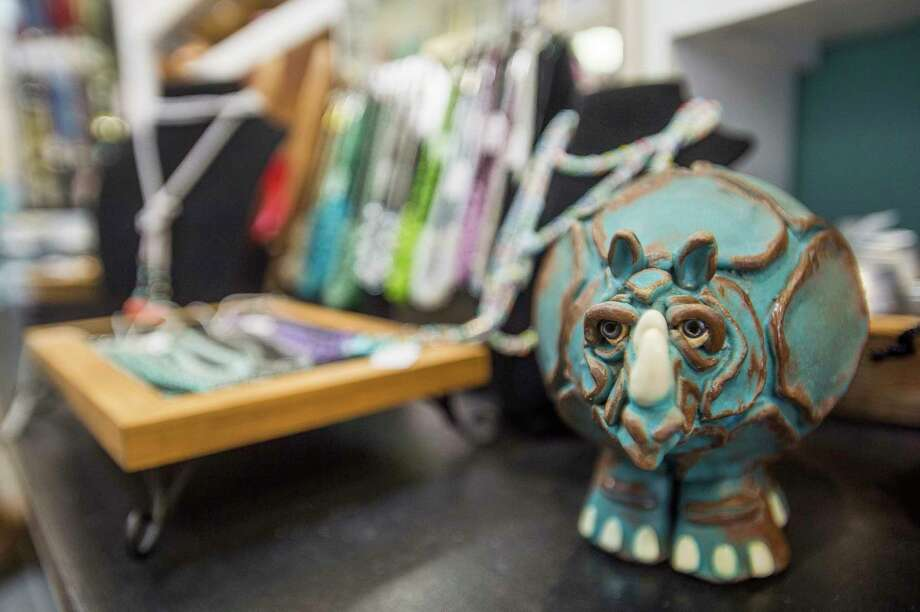 Handcrafted items made by local artists are displayed inside Imagine That! on Main Street, which celebrates its 15th anniversary this week. (Katy Kildee/kkildee@mdn.net)