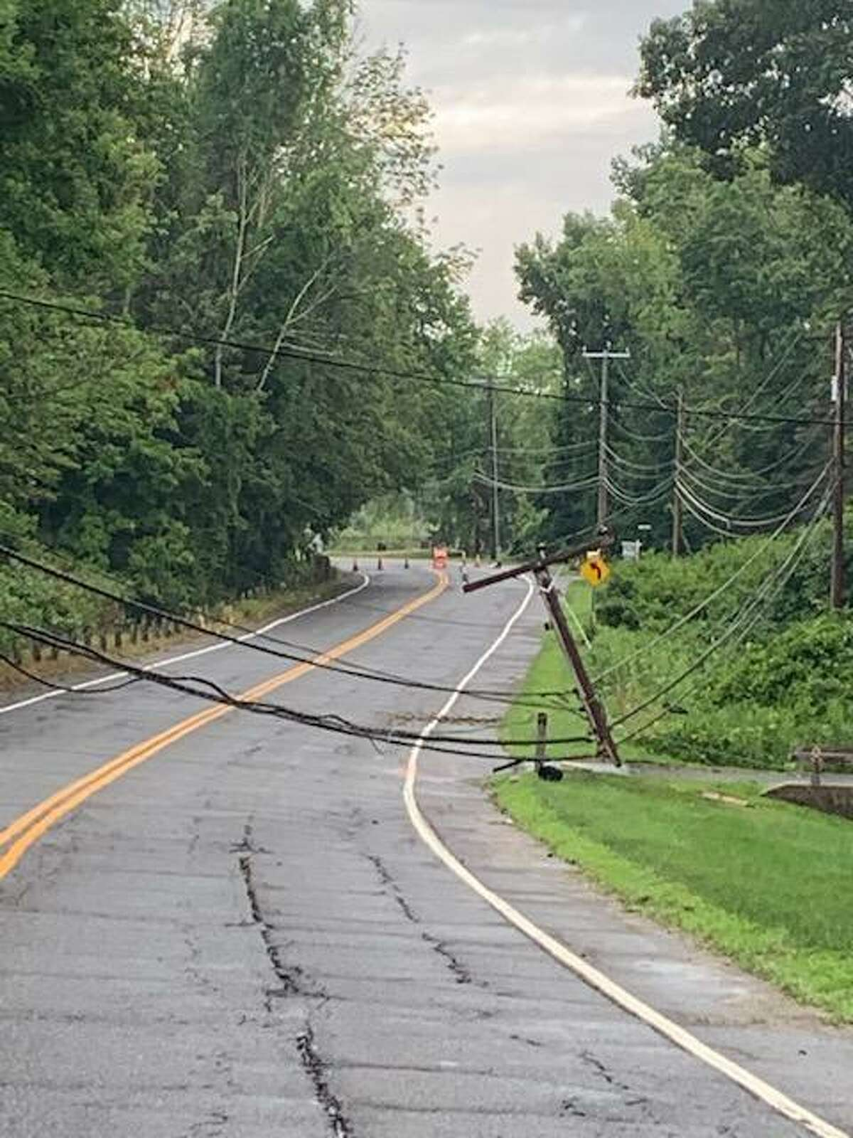 A broken pole and downed wires in the area of 177 Route 37 in New Fairfield following Tropical Storm Isaias.