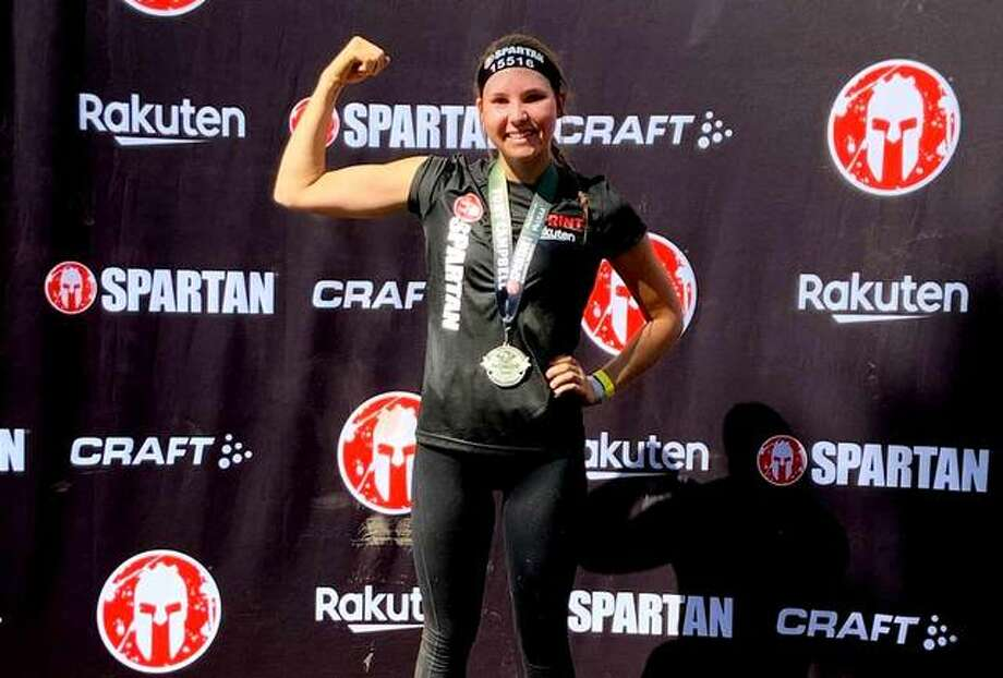 Kristen Ingold flexes after finishing her first Spartan Race at Fort Campbell, Kentucky on Oct. 20, 2019. Photo: Courtesy Of Kristen Ingold