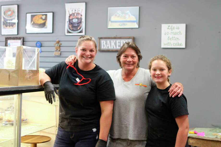 (From left) Niki Stricker, Doni Cassiey and Maddy Stricker work hard every day to bring a wide variety of sweet treats to the people of Big Rapids at The Pie wHole. Niki Stricker said the business would not be possible without the help of her family. (Pioneer photo/Taylor Fussman)
