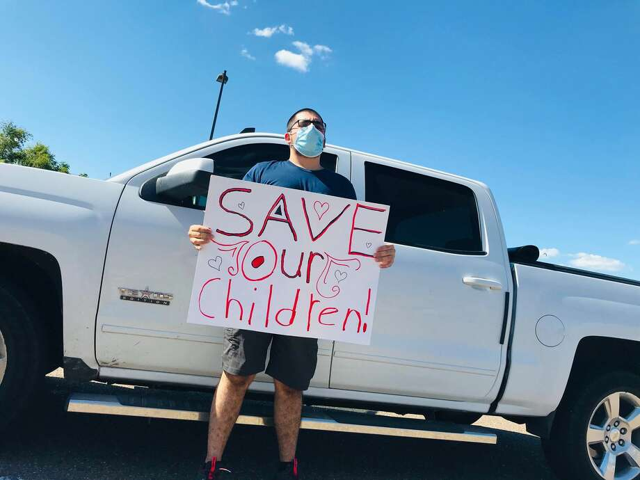 A protester is seen at an event Tuesday attempting to shed light on the issues of pedophilia and sex trafficking. Photo:  Courtesy Photo