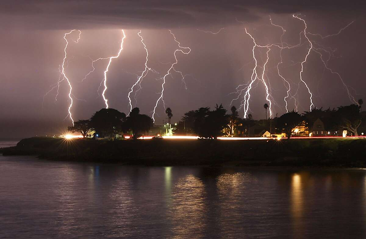 A rare lightning storm crackles over Mitchell's Cove in Santa Cruz, California around 3 a.m. Sunday morning August 16, 2020. The severe storm system rolled through the San Francisco and Monterey Bay areas early Sunday, packing a combination of dry lightning and high winds that triggered wildfires throughout the region. The National Weather Service on Sunday extended a red flag fire warning for the entire Bay Area until 11 a.m. Monday morning. (Shmuel Thaler/The Santa Cruz Sentinel via AP)