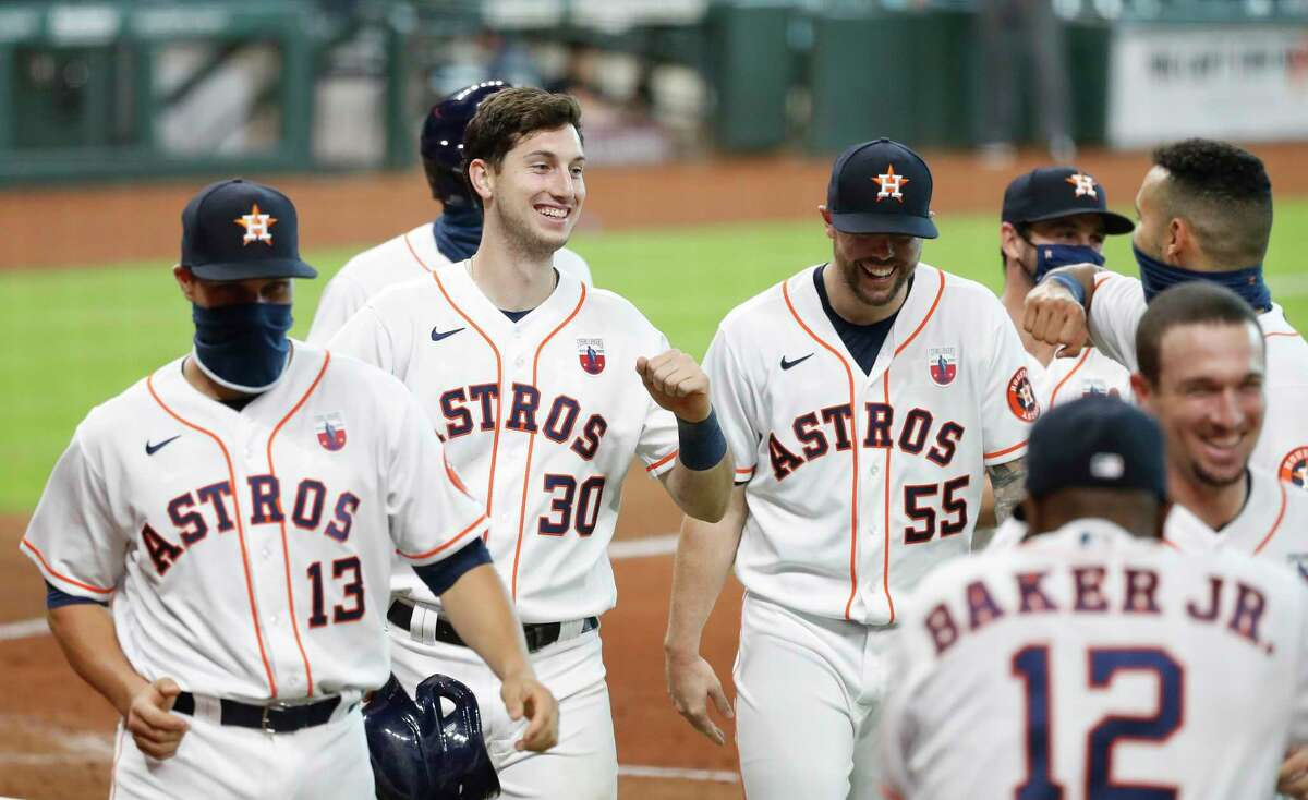 Houston Astros Kyle Tucker (30) smiles with teammates after hitting a walkoff home run during the ninth inning of an MLB baseball game at Minute Maid Park, Sunday, August 16, 2020, in Houston. Astros win 3-2 against the Seattle Mariners.