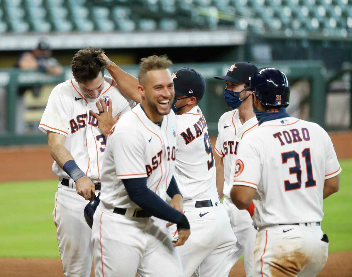 Houston Astros Kyle Tucker (30) is grabbed by Jack Mayfield after hitting a walkoff home run during the ninth inning of an MLB baseball game at Minute Maid Park, Sunday, August 16, 2020, in Houston. Astros win 3-2 against the Seattle Mariners.