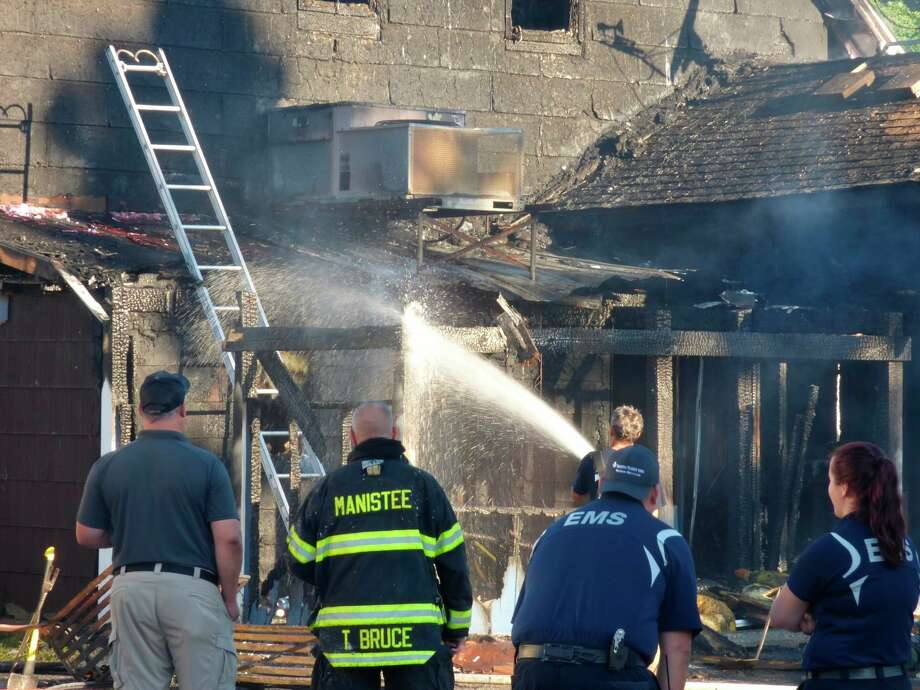Firefighters from Manistee Fire Department and several other local departments worked to put out a fire at the Hi-Way Inn on Aug. 11. (File photo)