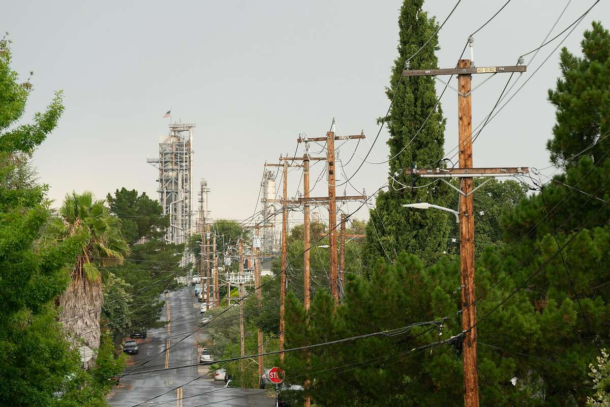 Power lines are seen on Palm Avenue in Martinez, Calif., on Sunday, August 16, 2020. California has ordered rolling power outages for the first time since 2001 as a statewide heat wave strained its electrical system.