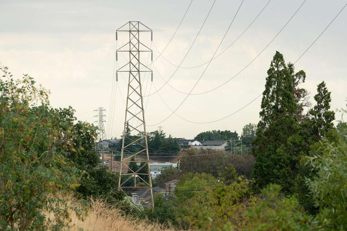 Power lines are seen on Palm Avenue and Vista Way in Martinez, Calif., on Sunday, August 16, 2020. California has ordered rolling power outages for the first time since 2001 as a statewide heat wave strained its electrical system.