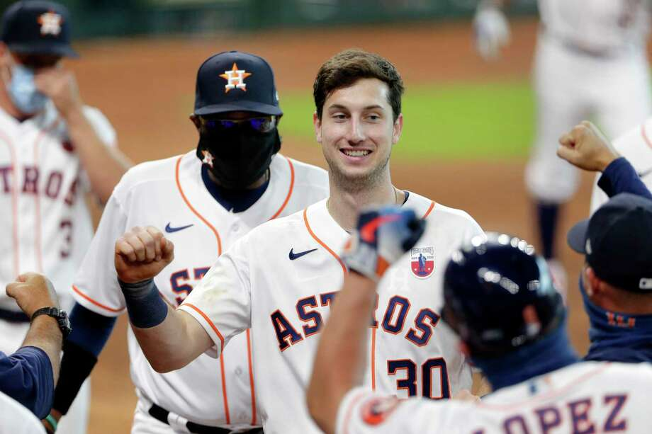 Houston Astros Kyle Tucker (30), is swarmed by teammates as he heads to the dugout after his walk-off home run in the ninth inning of a baseball game against the Seattle Mariners Sunday, Aug. 16, 2020, in Houston. Photo: Michael Wyke, FRE / Associated Press / Copyright 2020 The Associated Press. All rights reserved.