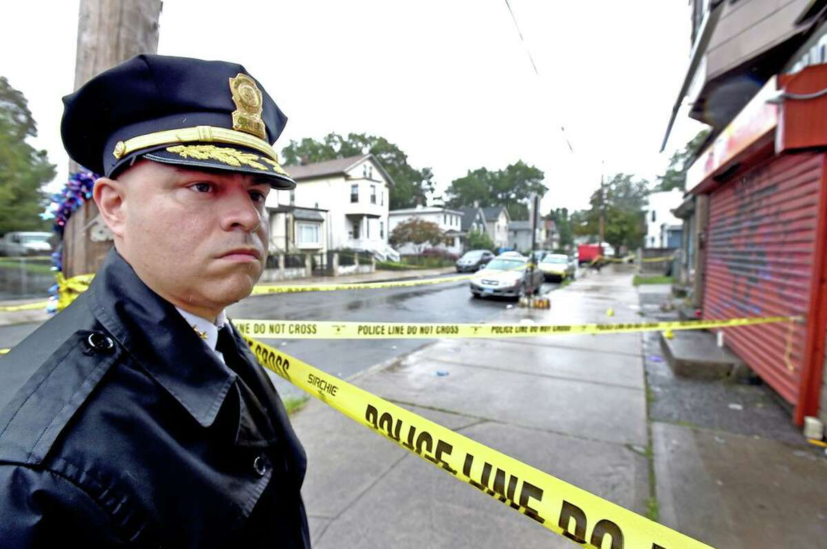 In this file photo, New Haven Police Chief Otoniel Reyes after a press conference on Wilson Street near the crime scene in aug. 2020 where one person died and five were wounded in a Saturday night shooting in New Haven's Hill neighborhood.