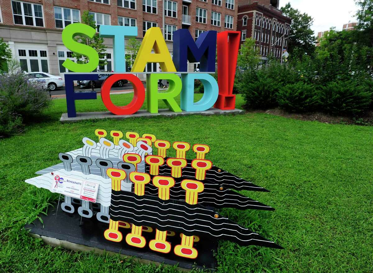 A colorful and a big statue of letters, with STAM atop of FORD is photograph on Wednesday, is the focal point and anchor at the corner of Main Street and Washington Blvd. near the UCONN Stamford housing in Stamford.