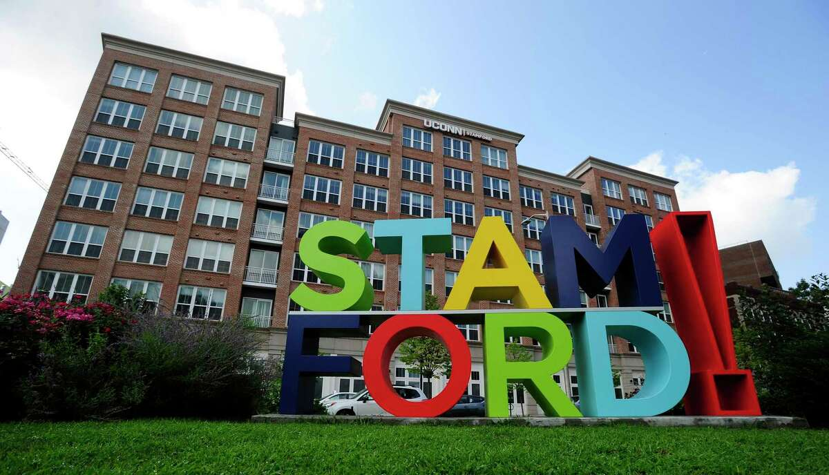A colorful and a big statue of letters, with STAM atop of FORD is photograph on August 12, 2020 is the focal point and anchor at the corner of Main Street and Washington Blvd. near the UCONN Stamford housing in Stamford, Connecticut.