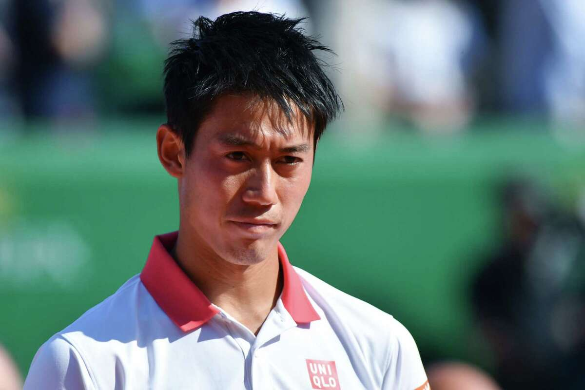 Japan's Kei Nishikori looks over during the trophy ceremony after being defeated by Spain's Rafael Nadal in their final match at the Monte-Carlo ATP Masters Series tournament on April 22, 2018, in Monaco. Nadal, 31-years-old, saw off Nishikori 6-3, 6-2 to become the first man to win a tournament 11 times in the Open era with his 76th ATP Tour triumph. Nadal's 31st Masters title is also an outright record, pulling him out of a tie with Novak Djokovic. / AFP PHOTO / YANN COATSALIOUYANN COATSALIOU/AFP/Getty Images