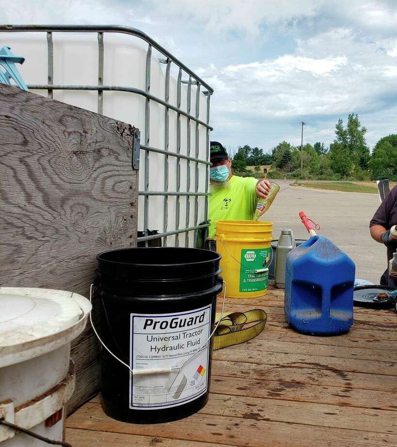Several from Oceana County were able to help offset costs of oil recycling by instead using it as a heat source. Motor oil was one of the popular items being collected on Saturday at the annualhazardous material collection event. (Arielle Breen/News Advocate)