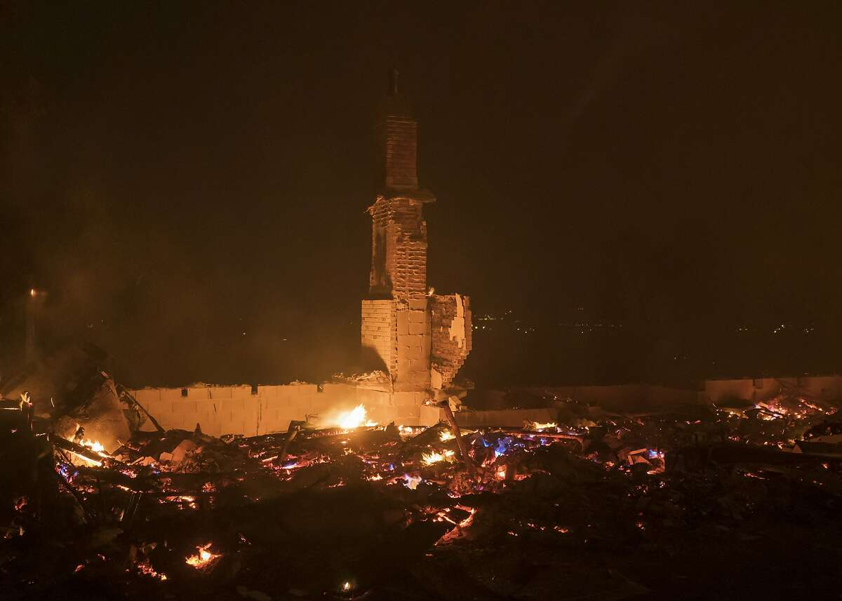 Flames lick at the remains of a house destroyed by the River fire near Salinas, Calif., Sunday, Aug. 16, 2020. (AP Photo/Nic Coury)