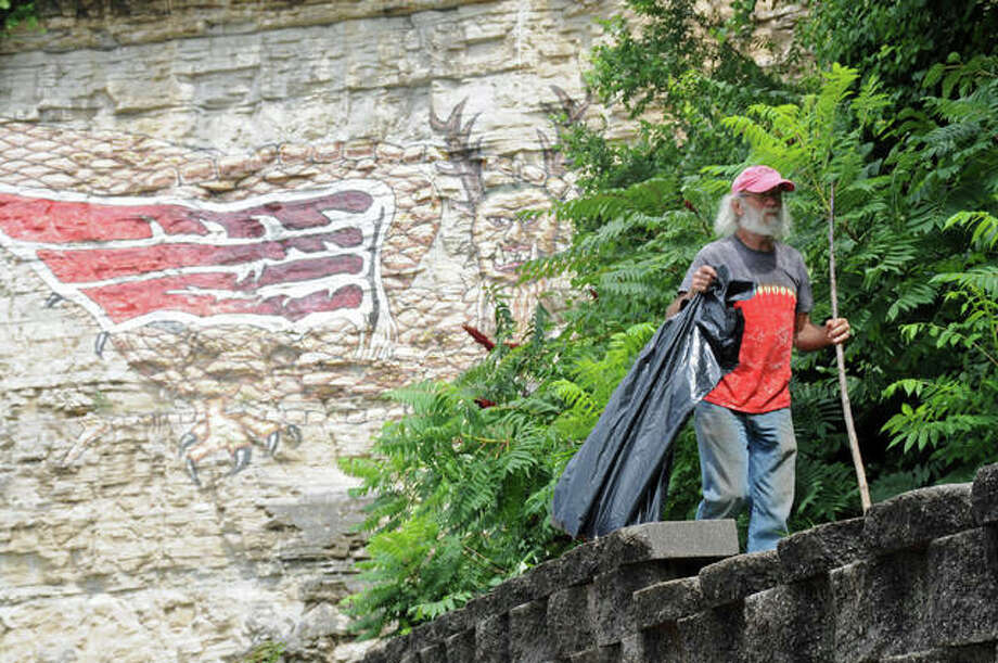 """Trinity's Way volunteer John Scanlon, of Godfrey, searches for trash during Trinity's Way's Piasa Park cleanup Sunday. Trinity's Way, a nonprofit organization founded in spring 2018, was formed in honor and memory to Trinity Marie Buel, whose 20th birthday was Aug. 6. Trinity's Way is """"dedicated to carrying on Trinity's legacy of kindness and compassion for animals and the environment."""" The group plans to hold another cleanup along their adopted stretch of U.S. Route 67, in Godfrey, in September or October. Date TBA at Trinity's Way's Facebook page. Photo: David Blanchette For The Telegraph"""