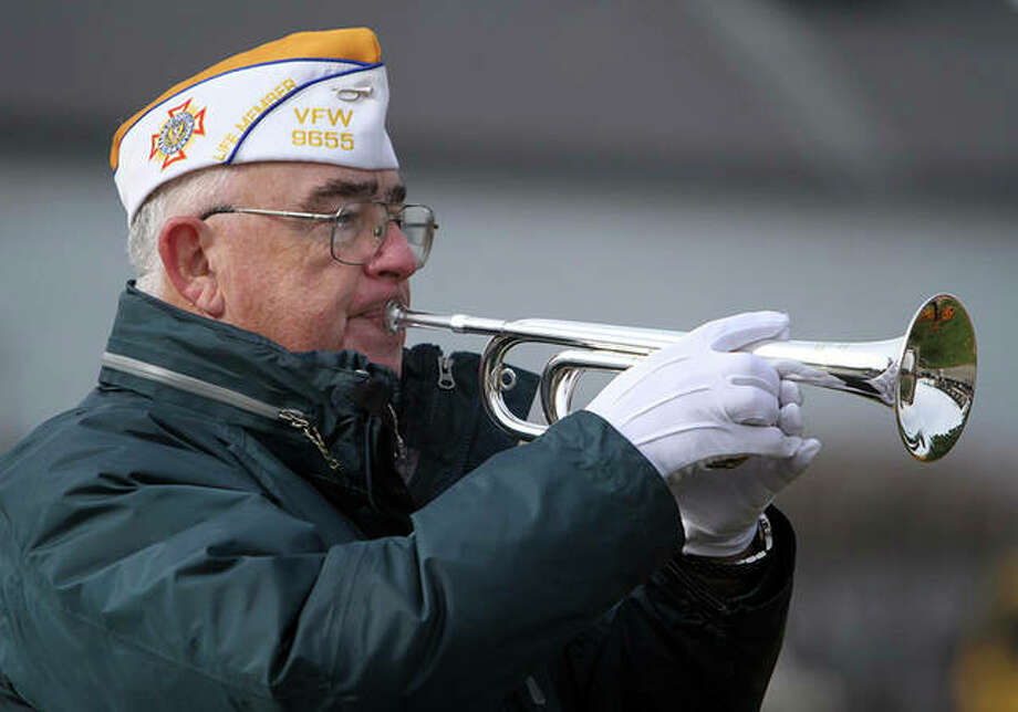 """Jim Reynolds plays the bugle at a Veterans Day ceremony in Fox Lake. Reynolds has been on a mission to play """"Taps"""" wherever and whenever he's needed as a solemn message of mourning and thanks for military service. He hasn't kept official track, but he estimates he's played at more than 1,000 functions. Photo: George LeClaire 