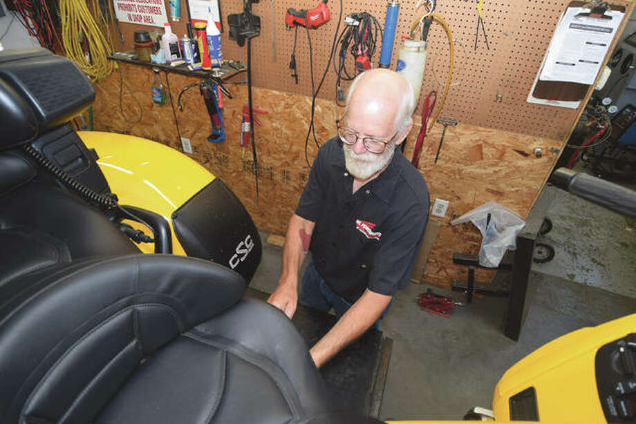 John Brewer spends the week before his retirement in the service bay at W.L. Powersports in Jacksonville. Photo: David Blanchette | Journal-Courier