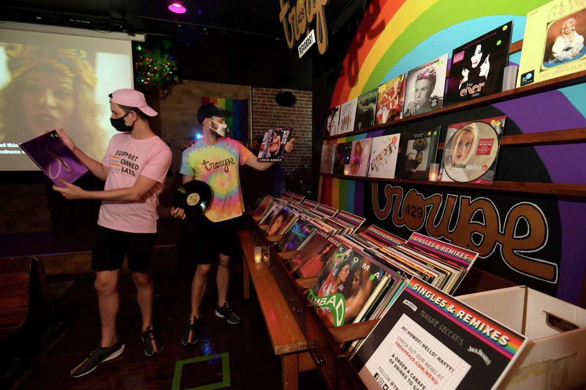 Nicholas Ruiz and Casey Fitzpatrick co-founders of Troupe429, a LGBTQ bar and performance space, have changed their dance floor into a vinyl record shop in response to the pandemic restrictions in Norwalk, Conn., has reopened as a vinyl record store offering outdoor refreshments in order to support itself as bars remain closed in Connecticut.