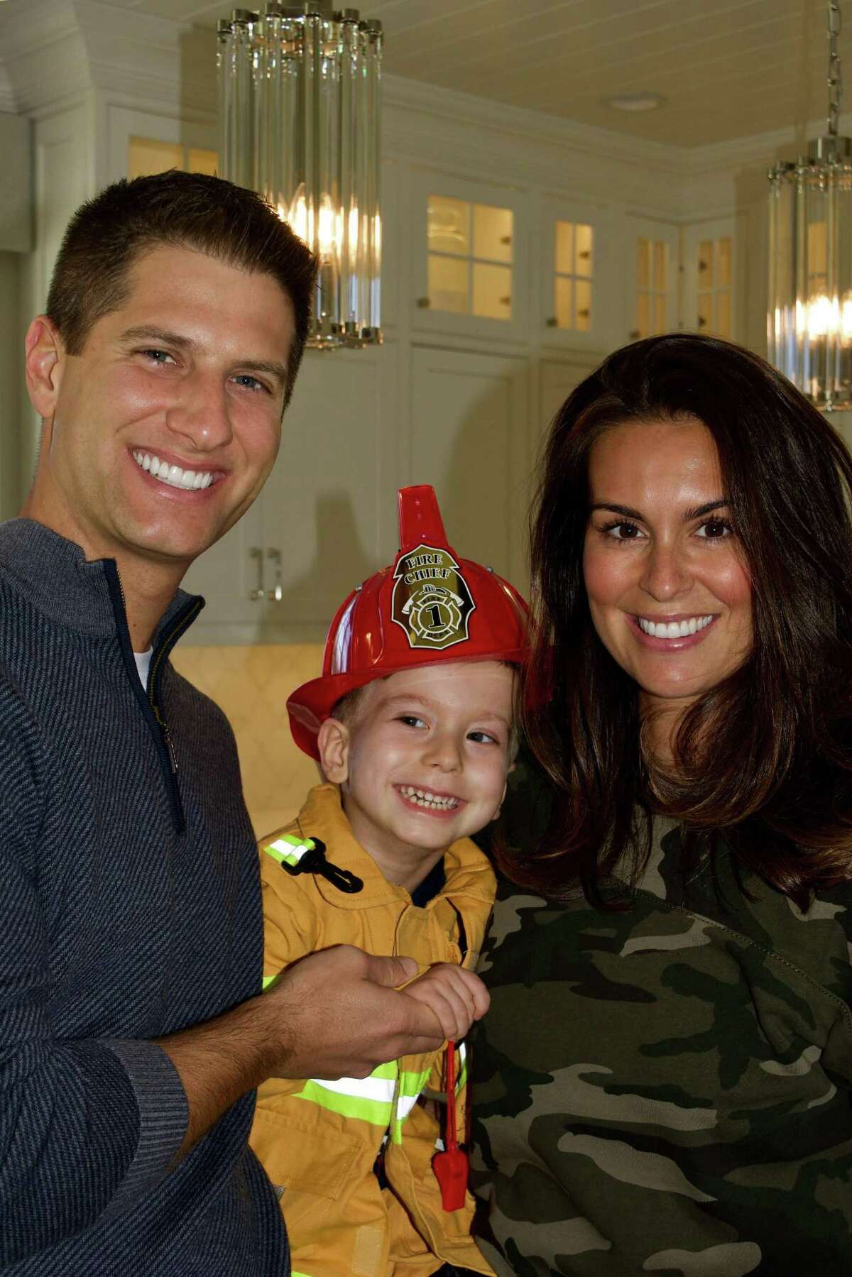 Carter Avellone of New Canaan, held by his parents Peter and Natalie. Natalie's