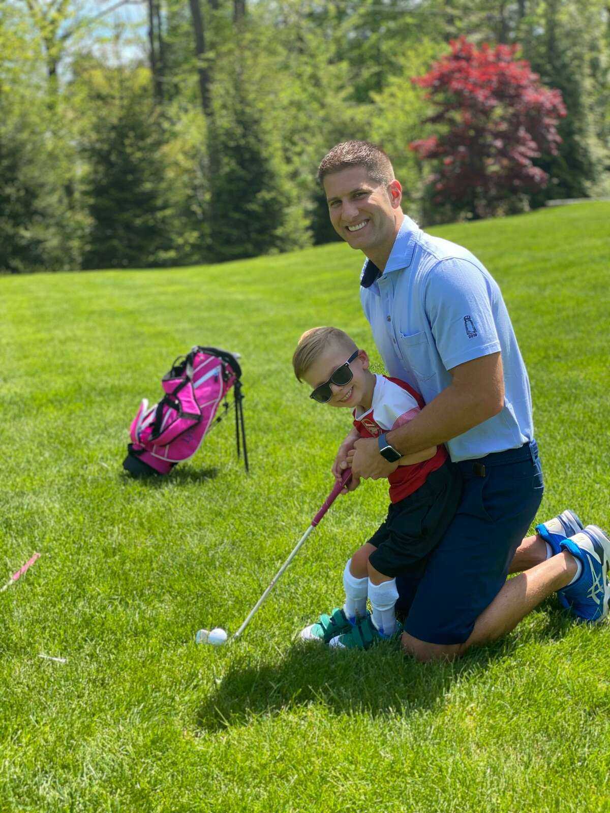 New Canaan's Carter Avellone plays from the rough with the help of his father, Peter. Carter is the subject of the Instagram page