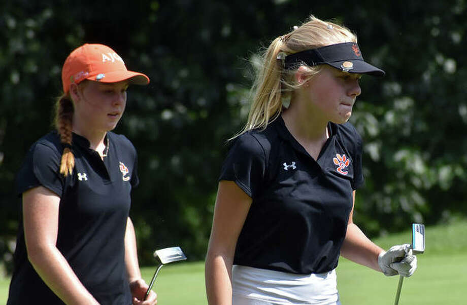 Edwardsville's Caitlyn Dicks, right, and Riley Lewis walk off the No. 14 green at Rolling Hills Golf Course on Saturday in Godfrey. Photo: Matt Kamp|The Intelligencer