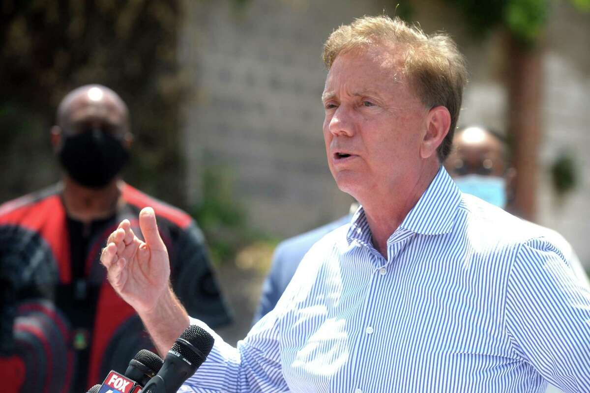 Gov. Ned Lamont speaks during a news conference next to the mobile COVIE-19 testing site set up outside Mount Aery Church, in Bridgeport, Conn. June 26, 2020.