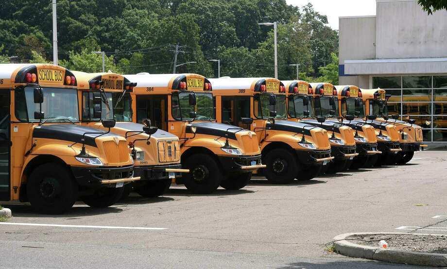 Durham School Services buses parked outside of the former Sears Auto Center at the Connecticut Post Mall in Milford on August 14, 2020 Photo: Arnold Gold / Hearst Connecticut Media / New Haven Register
