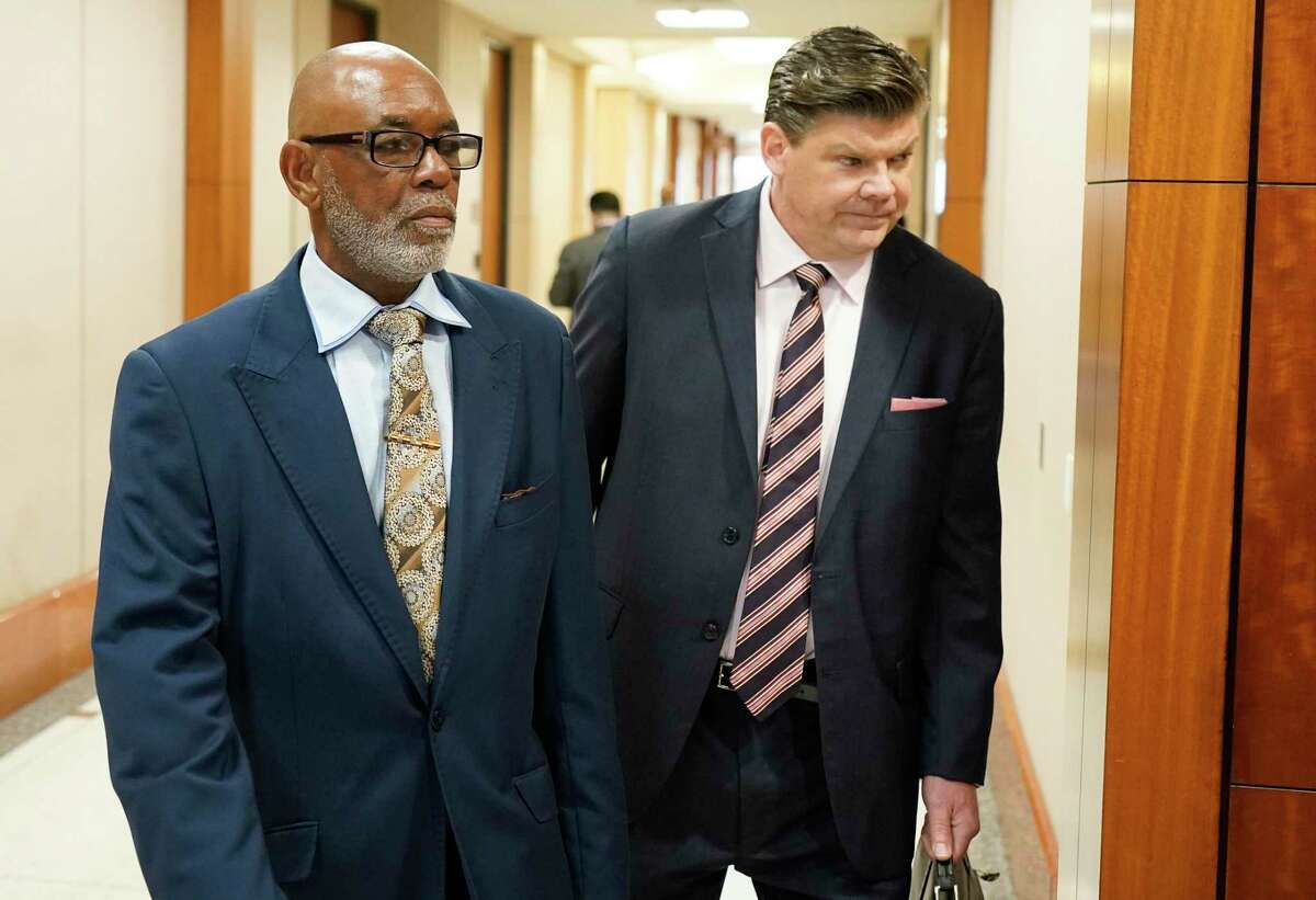 Otis Mallet, left, and his attorney Troy Locklear enter the 338th District Court Monday, Feb. 3, 2020, in Houston. District Judge Ramona Franklin declared Otis Mallet innocent of the 2008 drug charges that led to his conviction in 2011, after hearing arguments that the case was built on lies by former Houston police officer Gerald Goines.