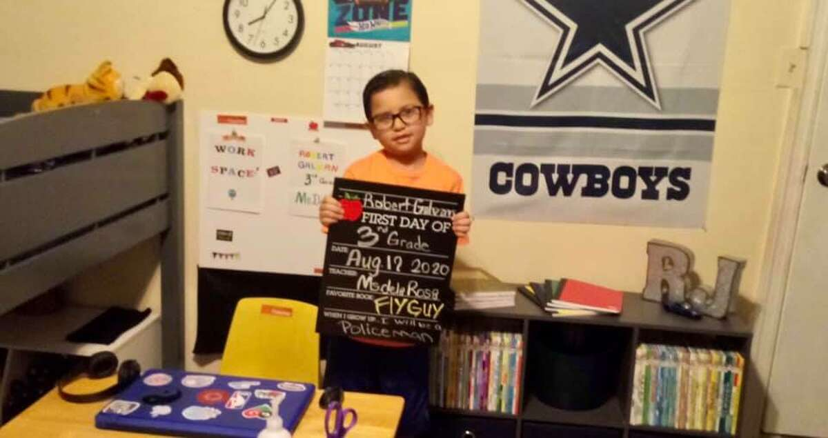 Third-grader RJ shows off his virtual learning setup for his first day of school.