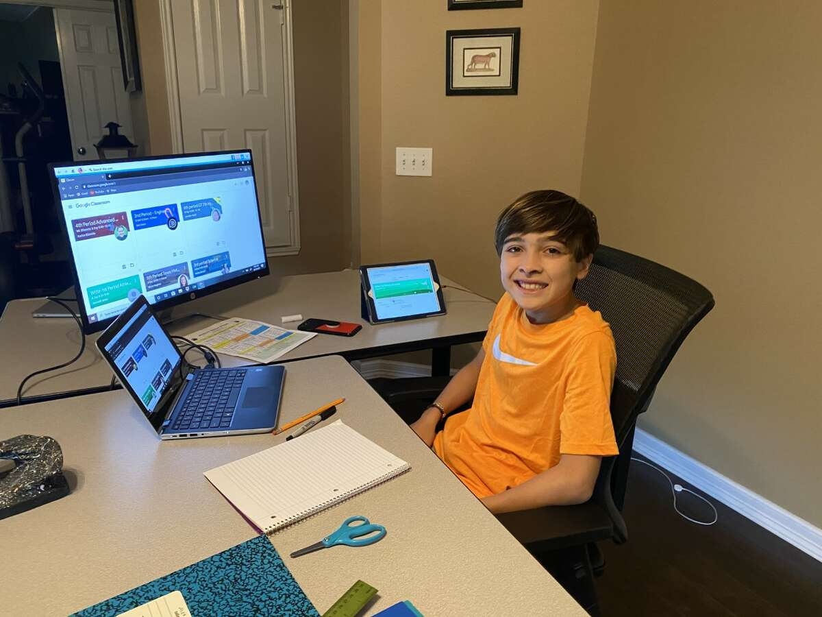 Tracy Henderson sent mySA.com a photo of her seventh-grader and his virtual learning setup on his first day of school.