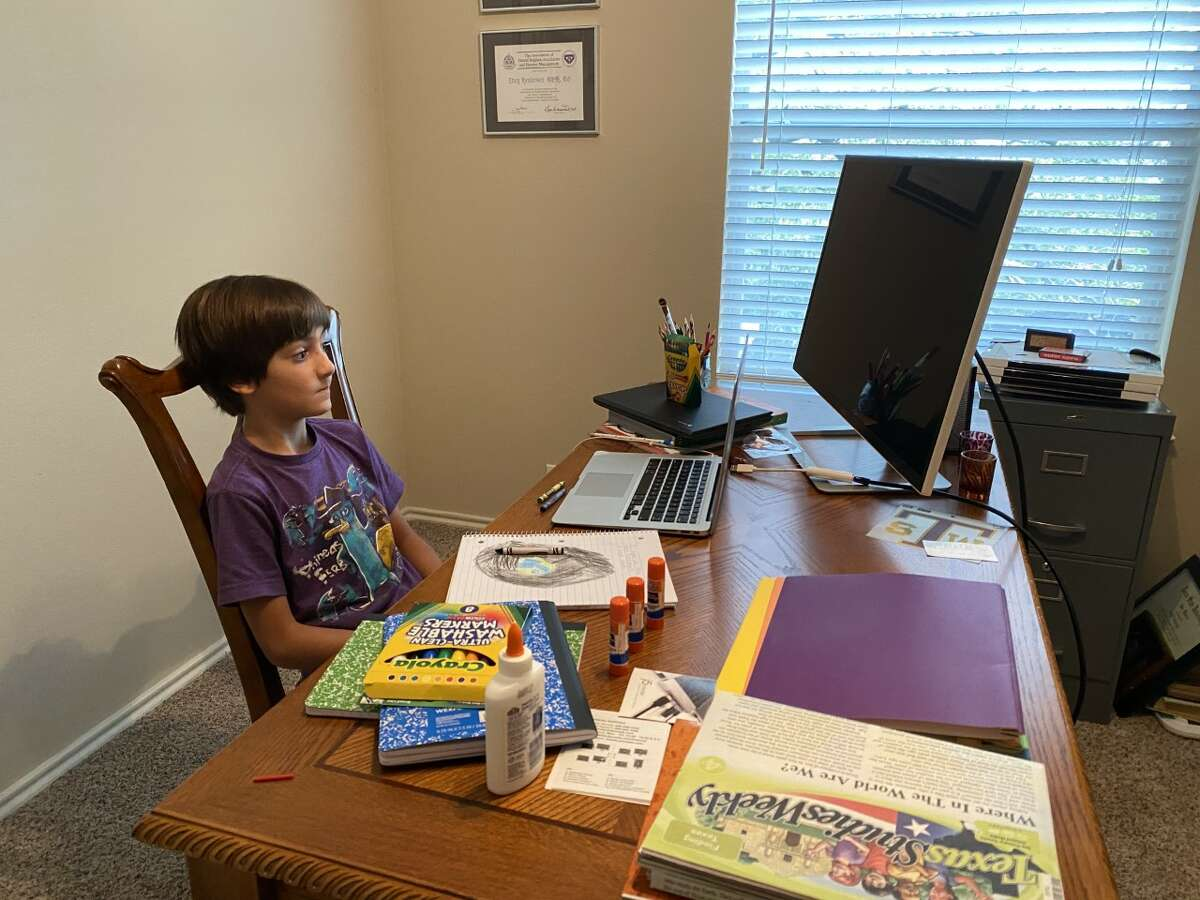 Tracy Henderson sent mySA.com a photo of her fourth-grader and his virtual learning setup on his first day of school.