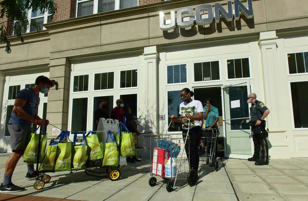 About 265 University of Connecticut-Stamford students moved into downtown residence halls on Friday.
