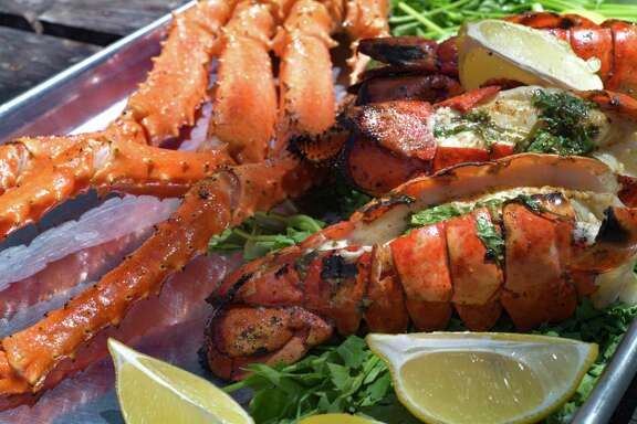 Grilled Alaskan King Crab Legs, top, and Grilled Lobster Tails