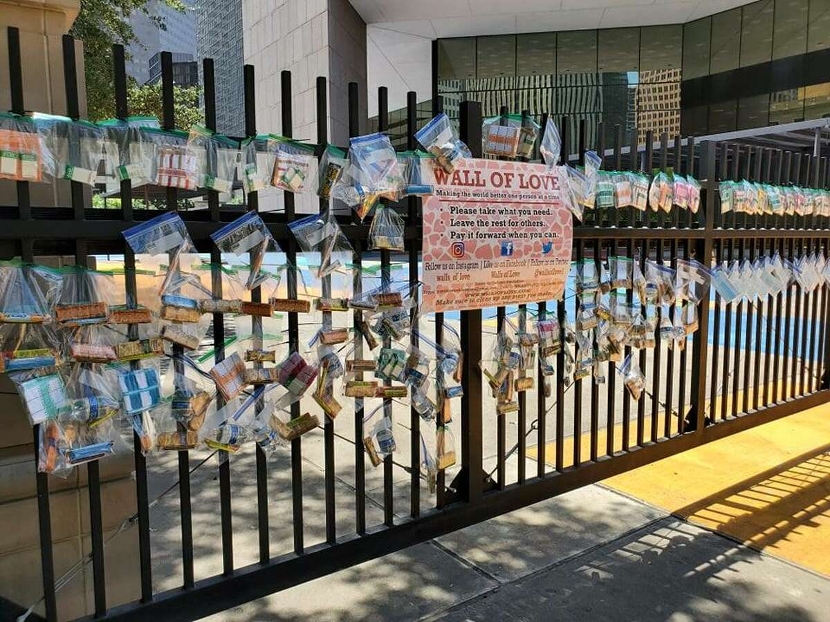Walls of Love was created by founder Holly Jackson with the mission of providing basic necessities within regions of poverty in various cities including Houston. >>>These photos depict the wall located in downtown Houston near City Hall that went up last week.