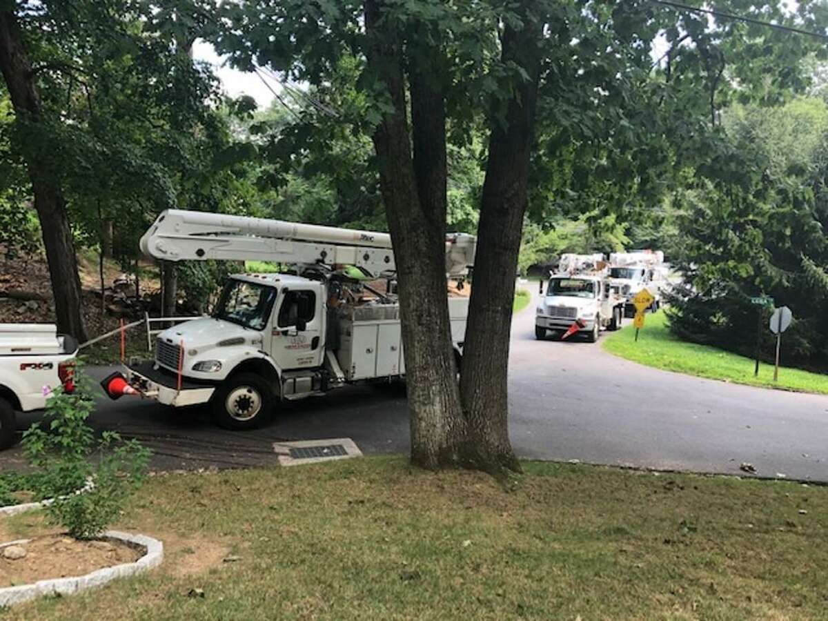 Adofo Briceno flagged down a foreman from Sumter Utilities of Ashville, N.C., who happened to be driving in his neighborhood. The crew fixed what several other crews failed to repair to restore power to Briceno's Wilridge Road home on Aug. 12, 2020 in Wilton, Conn.