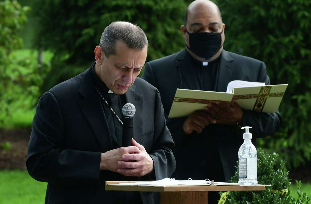 Bishop Frank Caggiano and the Rev. Reginald D. Norman lead the ceremony during the dedication of the Philip Tai-Lauria memorial garden at Our Lady of Fatmina Catholic Church Saturday, August 15, ,2020, in Wilton, Conn.