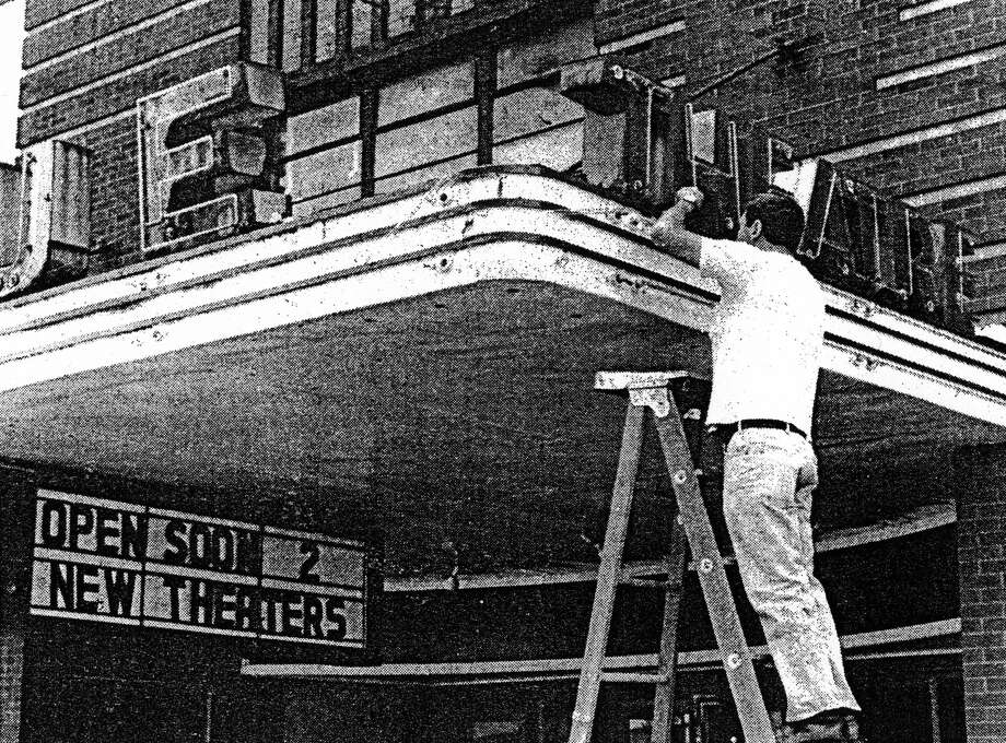 Local renaissance man Gary Sielski (a former employee of the Vogue Theatre) is pictured in May, 1985 fixing up neon on the front canopy of the Vogue. Photo: Manistee County Historical Museum Photo