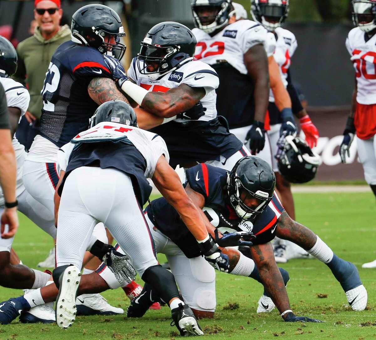 Houston Texans linebacker Benardrick McKinney (55) goes up against offensive tackle Rick Leonard (72) during an NFL training camp football practice Monday, Aug. 17, 2020, at The Houston Methodist Training Center in Houston.