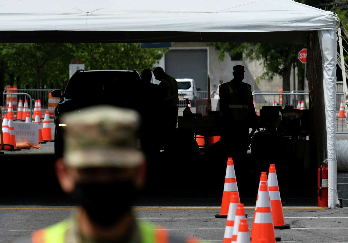 Testing for COVID-19 takes place at the University at Albany testing site on Monday, Aug. 17, 2020, in Albany, N.Y. The drive-through testing location has moved to the north side of State Quad off Washington Avenue. (Will Waldron/Times Union)
