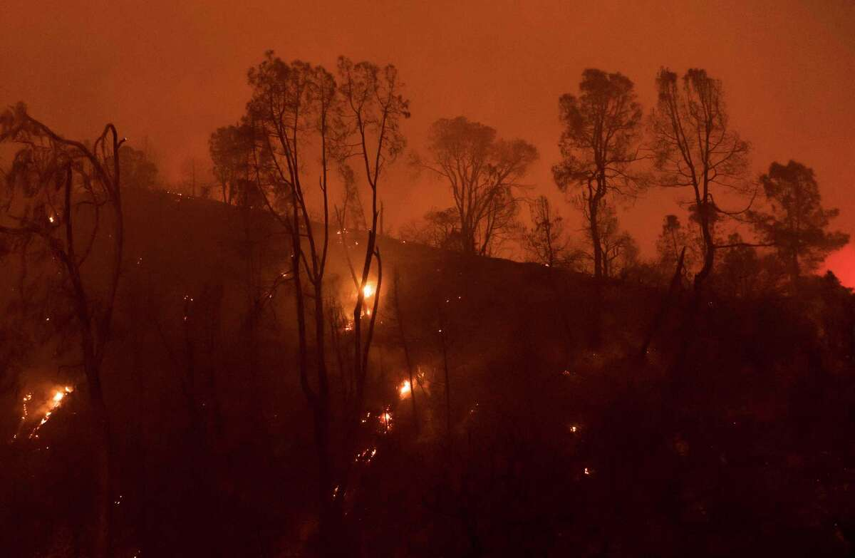 Trees and vegetation burn in the River fire near Salinas, Calif., Sunday, Aug. 16, 2020.