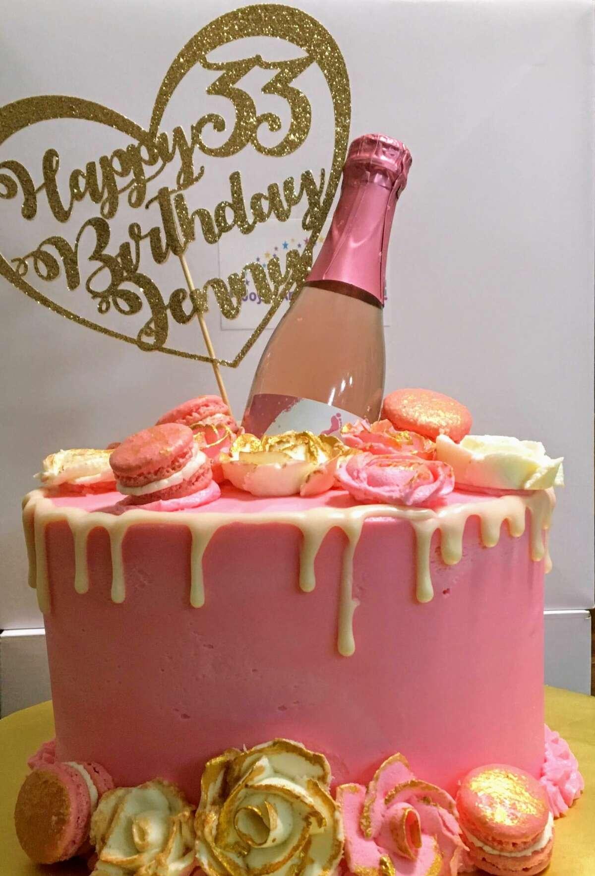 A birthday cake by JoyceAnn's Bakery.
