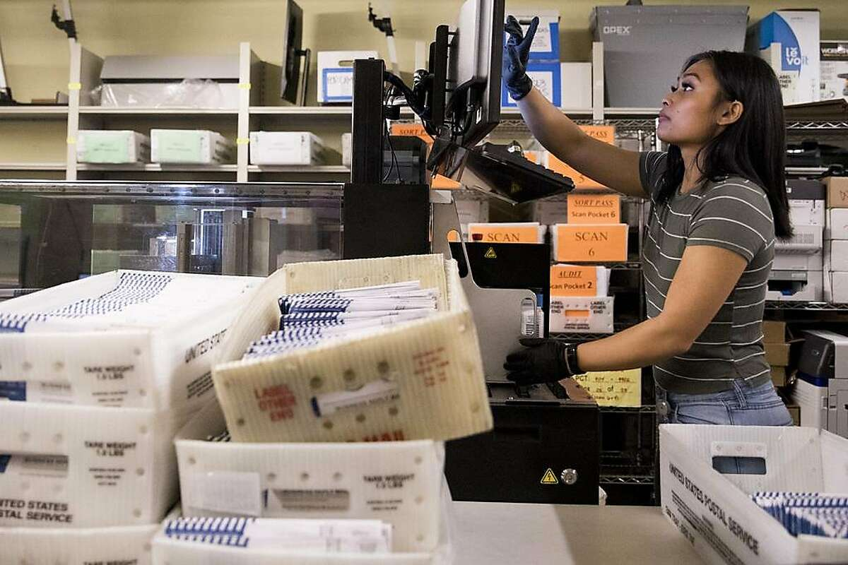Samantha Geronimo of Daly City works to sort out vote-by-mail ballots ahead of the March 3rd election at San Francisco City Hall in San Francisco, Calif. Friday, February 28, 2020.
