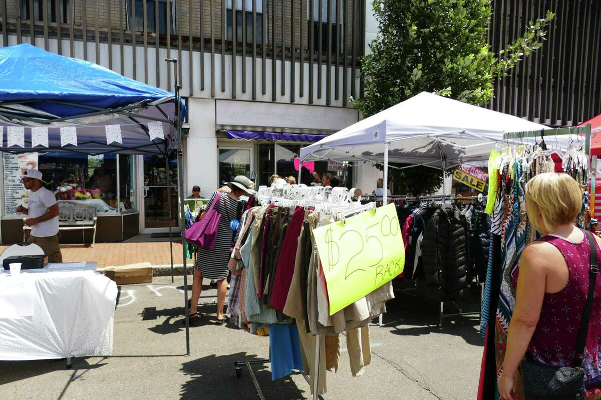 """Attendees of the 2019 Village Fair and Sidewalk sale in New Canaan shop for items at the event. Social distancing will be observed at this year's """"So Long to Summer Sale Friday, Aug. 21, and Saturday, Aug. 22, 2020."""