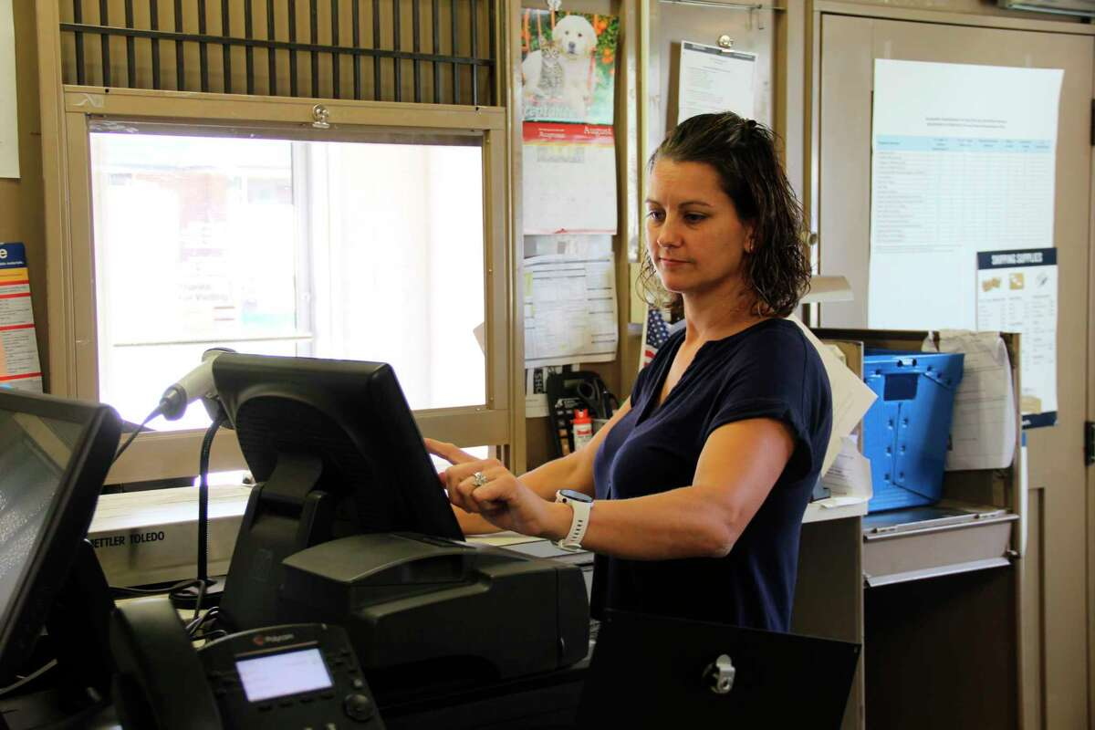 Donna Utter working at the Ubly Post Office. This location won a customer service survey contest and will celebrate with an ice cream social. (Robert Creenan/Huron Daily Tribune)