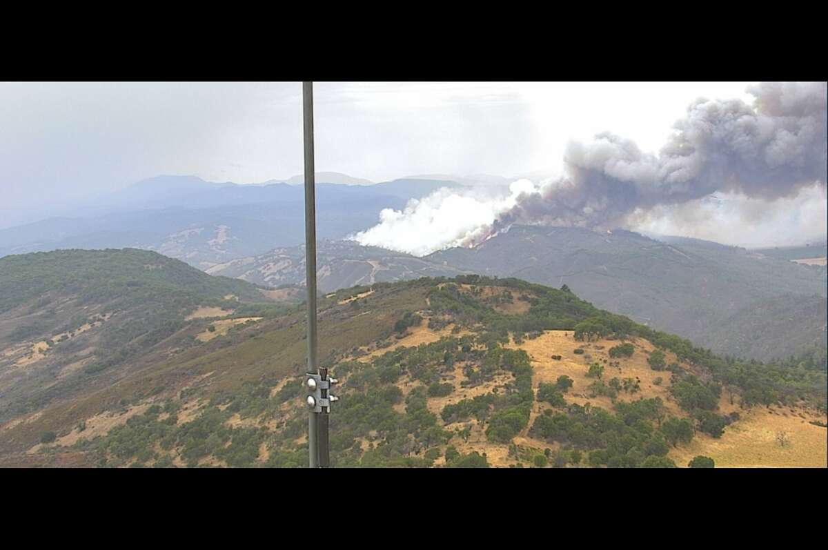 An image from a PG&E webcam showing a fire at St. Helena continues to burn in the North Bay.