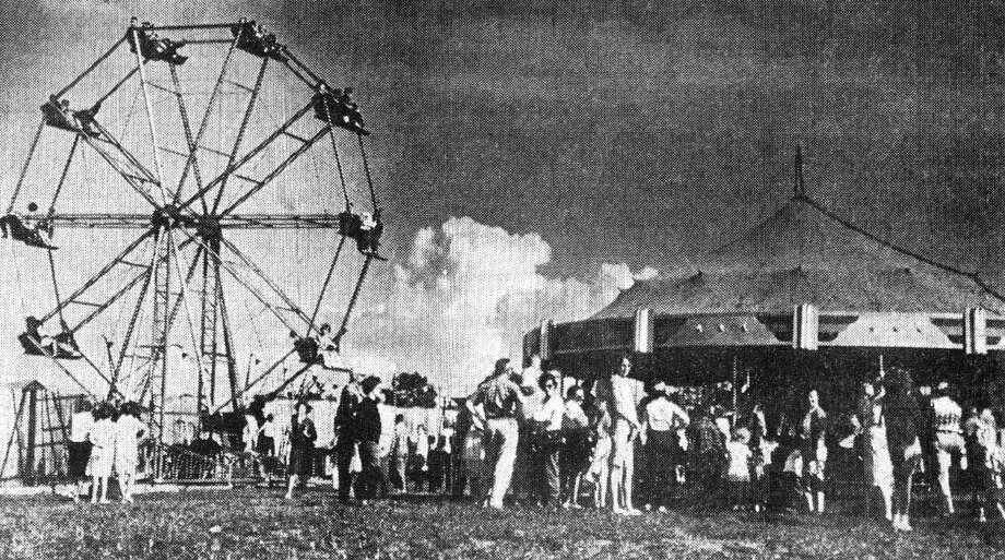 The ferris wheel and carousel at The Manistee County Fair in 1963. (Manistee County Historical Museum photo)